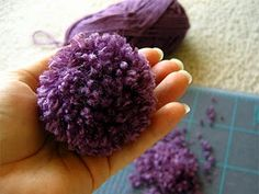 how to make pom pom flowers. GREAT DIY site! tons or deocrating ideas