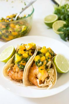 Tropical Coconut Shrimp Tacos with a chili lime coleslaw and mango papaya salsa - seriously the BEST taco I have ever had!