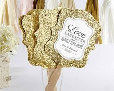 Product Description: - Details - Shipping - Dimensions As part of the Huemane Love Is Golden Collection, these versatile fans are simply to die for! Each place setting will sparkle and do double duty