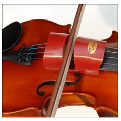 Looking for a teaching aid to help students with their bow hold? The BowZo allows contact with the strings only when the bow is at a 90 degree angle.