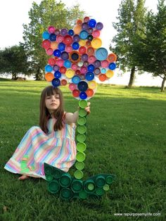 repurposed plastic lids create fabulous garden art