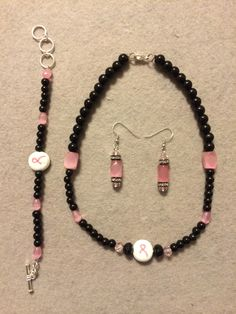 The Diana Collection features a White and Pink Survivor Ribbon bead surrounded by black pearls and pink cats eye beads. Wear this Collection in memory of all those who have lost their battle to breast cancer. Diana B
