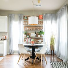 Dining nook with white modern chairs and IKEA Skogsta wood wall shelve Ikea Shelves, Bookcase Storage, Book Storage, Wall Shelves, Storage Ideas, Book Organization, Ikea Storage, Book Shelves, Shelf
