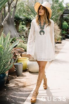 Rocky Barnes defines boho chic with a long-sleeve white crochet dress and chunky lace-up sandals. Shop her street style look now! #LoveGUESS