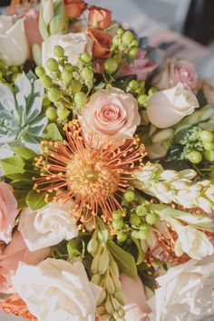 peach flowers with orange pincushions // photo by Anna Delores // http://ruffledblog.com/coral-santa-fe-springs-wedding