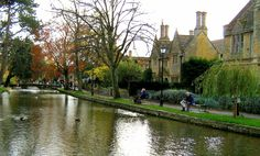 Bourton on the Water, Cotswolds, England - We lived about 3 miles up the hill from here. We loved to come down to the village. I would bring my girls down for cream tea. I still dream of those scones and clotted cream and jam!!! In the summer people would be sunbathing all along the bank while their children splashed around in the water. We had a fish and chip shop that we loved to go to.