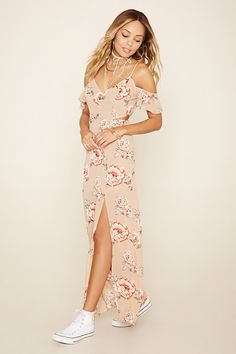 A woven maxi dress featuring an allover floral print, short open-shoulder sleeves, side cutouts, adjustable spaghetti straps, V-neckline and a side slit.
