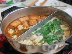 Chinese hot pot is one of the ultimate communal dining experiences: diners sit around a table, dipping prepared meats, seafood, and vegetables into simmering broths to quickly cook before eating. All that's required are a few key pieces of equipment and all the ingredients prepped right. Here's how to host a hot pot feast at home.