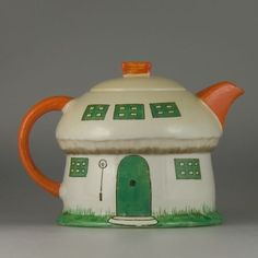 """hand painted Shelley """"Boo Boo"""" teapot, formed as a house in the shape of a mushroom, designed by Mabel Lucie Attwell in 1926."""