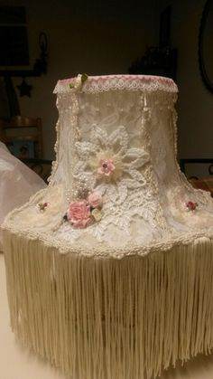 Old lampshade revamped into shabby/Victorian. Like all but the long tassels.
