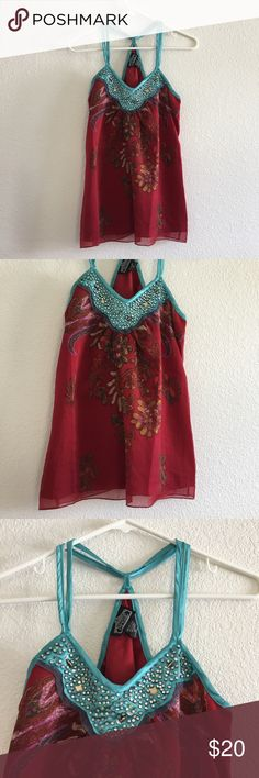 """Angie Top Blouse Red Blue Beaded Flowy Boho Print Women's Angie Boutique Blouse  Size Medium  Gorgeous red and blue beaded blouse. Halter style, loose, flowy fit. Bohemian floral print.  Good condition! Small mark on the back, as pictured. Not very noticeable when worn!   Flat Lay Measurements: Length 26"""" Armpit to Armpit 16""""  Comes from my smoke-free home. Make an offer Angie Tops Blouses"""