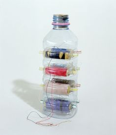thread dispenser made from a repurposed plastic water bottle. No instructions, this is from an art installation. I can't figure out how he by glenda