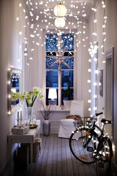 Tweak a strand of existing lights by adding stars or snowflakes, then create a dramatic canopy across your hallway. This image comes from a past IKEA catalog shoot but there's a great tutorial from http://www.monmakesthings.com/2013/04/star-light-star-bright-light-garland.html. (via apartment therapy.com)