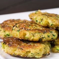 Zucchini Cakes. Freshly shredded zucchini with Parmesan cheese, garlic and spices, pan fried until golden brown. YUM!