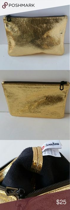 Marc Jacob Metallic Gold Leather make up bag Lovely Metallic gold crinkled make up bag  Neiman Marcus for Target, used but in a very good condition  Has a little black mark on it.Took pictures showing the mark. Please take a look at the pictures before buying.  Add my closet my closet to your favorite list for new arrivals. Offers through offer button only. Marc Jacobs Makeup Brushes & Tools