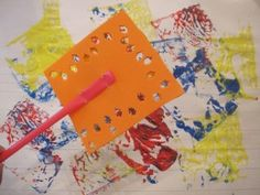 Fly swatted painting with DIY fly swaggers (from foam, draws, and hole punches