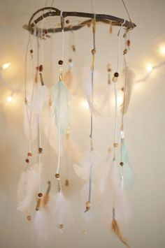 This is so soft and subtle, with its white, cream, and light green feathers that hang up to one and a half feet from the willow. It features white