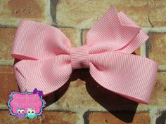 A personal favorite from my Etsy shop https://www.etsy.com/listing/236039055/pinwheel-hair-bow-back-to-school-hair