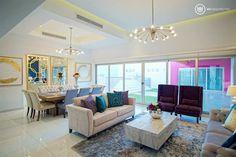 A856: Salas de estilo moderno por UV Arquitectos