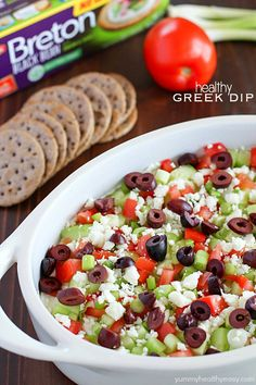 Deliciously healthy greek dip, made with a protein-rich cottage cheese base (with ranch seasonings!) then topped with cucumbers, green onions, tomatoes, kalamata olives, and feta cheese. Healthy and full of flavor! #breton #ad #breton #ad