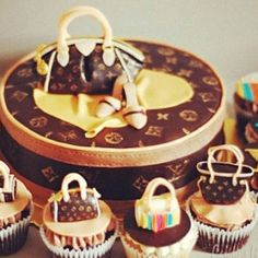 If you love designer handbags as much as I do, then you will absolutely adore these Louis Vuitton cake and cupcakes. Great for birthdays and showers, this cake ensemble has a round hatbox in the middle with purse and shoes on top, and LV cupcakes surroun Bolo Chanel, Chanel Cake, Fairy Cakes, Cupcake Kunst, Beautiful Cakes, Amazing Cakes, Cake Cookies, Cupcake Cakes, Cupcake Art