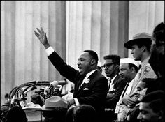 """I Have A Dream    WASHINGTON, D.C.—At the climax of his """"I Have A Dream"""" speech, Martin Luther King Jr. raises his arm on the steps of the Lincoln Memorial and calls out for deliverance with the electrifying words of an old spiritual hymn, """"Free at last! Free at last! Thank God Almighty, we are free at last!"""", 1963."""