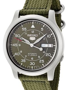 Seiko SNK805K2 automatic watch comes with a stainless steel case with a green canvas strap. It features a Seiko self winding movement, luminous hands and hour markers, day and date display, and an exhibition back.