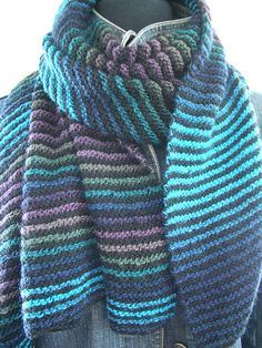 Garter Trap by my friend Andra Asars. Free pattern. Trapezoidal #knit-scarf or #knit-shawl uses garter stripes of a solid and self-striping (long stripes) #yarn. As Andra says, hands are busy but mind is left to wander.