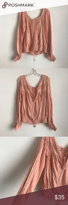 Free People Crochet Tie Peasant Blouse Light pink salmon color. Super adorable Blouse with great detailing everywhere! Cute tie back and details on sleeves. Great condition Free People Tops Blouses