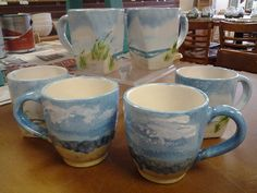 Hand painted beach scene ceramic coffee mugs www.studio12hatteras.com