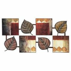 Multicolored metal and wood wall decor with a leaf motif.
