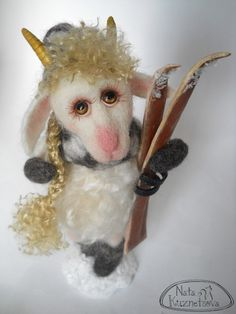 "NATALIA KUZNETSOVA - (artwool) -- ""Mountain goat, sports"" -- May 5, 2011 -- Goat height 20 cm..  Materials:  wool, mohair, Fimo, framed base.  Handmade."
