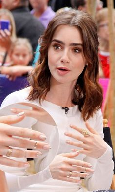 Lily Collins with silver detail nails