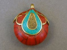 Tibetan Red Healling Amulet with Turquoise Brass and Red Copal Inlay