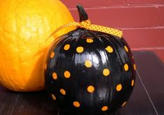 Polka dot pumpkin, just stickers and spray paint.