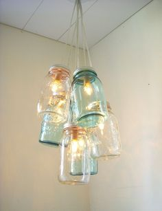 Ball Mason Jar Chandelier. I think I need to do a variation of this for our porch lights. Nothing ever quite works when we shop for new fixtures. I think this might do it! JM