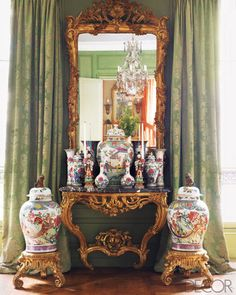 "The mirror and console in the drawing room are Louis XV, and the porcelains are a mix of ""Famille Rose"" and 17th-century delft; the draperies are of a Lelièvre silk brocade."
