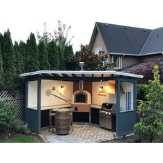 "corner pizza oven outdoor kitchen design ideascorner pizza oven outdoor kitchen design ideasThe ""classic"" Portuguese brick pizza oven with cast aluminum door - - Outd .The ""classic"" Portuguese brick pizza oven with cast aluminum door Pizza Oven Outdoor, Outdoor Kitchen Bars, Backyard Kitchen, Outdoor Kitchen Design, Brick Oven Outdoor, Rustic Outdoor Kitchens, Outdoor Grill Area, Outdoor Grill Station, Kitchen Brick"