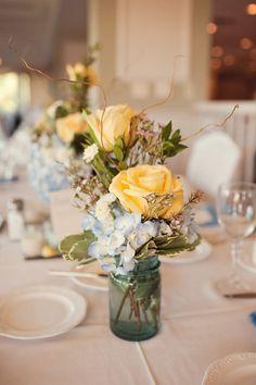 Simple but elegant arrangements in blue mason jars.