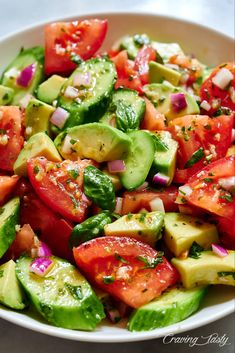 Delicious and addictive, this Tomato, Cucumber and Avocado Salad will make you prepare it again and again. Make it a few hours before serving - it will only get better. Cucumber Avocado Salad, Avocado Salad Recipes, Tomato Salad, Healthy Salad Recipes, Avocado Toast, Veggie Recipes, Healthy Snacks, Cooking Recipes, Avocado Smoothie