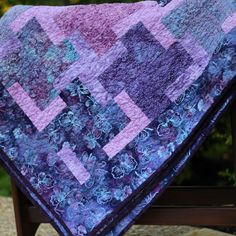 I made this quilt of pink, purple, and aqua batiks for our nanny.  #DIY #quilt #NannyGift