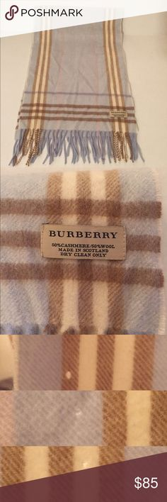 "Authentic baby blue Burberry scarf. Authentic Burberry 50% wool 50% cashmere done in a soft baby blue novacheck pattern. Last pics shows wear, wear is only noticeable upon close inspection or if held up against the light. Wear is not visible while worn. Length 52"", Width 12"" Burberry Accessories Scarves & Wraps"