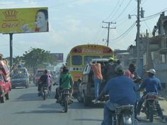 American school buses repurposed for public transportation in Haiti