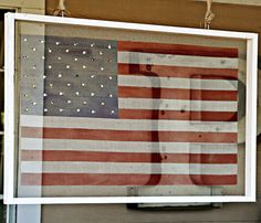 American flag painted on a framed screen.
