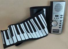 2012 NEW new novelty toy Hand Roll Piano 61 Keys - Digital & Portable by FlashingBoards. $55.99. This toy is a fun and educational gift for kids!. Rolls up for easy portability or storage. Easy to learn and quick to master!. Create music whenever and wherever you choose!. Features:61 Thickened Keys on Keyboard128 different Tones & Rhythms30 Demonstration SongsSingle Finger/ Finger Chords8 drum setsLCD DisplayRecord feature - you can record the music you playMIDI-out possible (re...