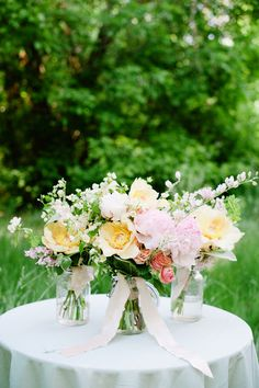 Peonies and spring blooms bouquet by Sarah Winward. Photo by Heather Nan