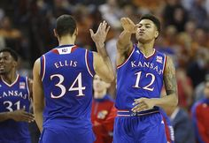 Kansas guard Kelly Oubre Jr. (12) slaps hands with Kansas forward Perry Ellis (34) during the second half, Saturday, Jan. 24, 2015 at Frank Erwin Center in Austin, Texas.