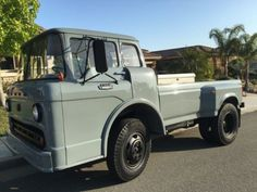 This 1965 Ford C600 (chassis C61BV723611) has been converted to a pick-up via fitment of a surprisingly harmonious looking 90's era F-series dually bed. The truck looks cool in recently sprayed grayish-green paint, though a few cabin details could stand to be better resolved. Regardless, the se