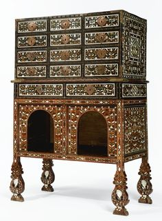 A FINE AND RARE INDO-PORTUGUESE GILT-COPPER-MOUNTED IVORY INLAID HARDWOOD CABINET ON STAND (CONTADOR) LATE 17TH CENTURY, GOA
