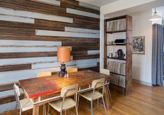 Reclaimed wood wall, mixing painted and unpainted salvaged boards.